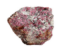 Natural sample of eudialyte crystals in nepheline syenite isolated on a white background. Natural rock specimen of eudialyte, a rarity minor gemstone, in royalty free stock images