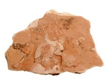 Natural sample of marlstone marl rock on white background. Natural specimen of marlstone rock - sedimentary rock composed of calcium carbonate or lime-rich mud Stock Photos