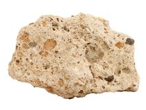 Natural sample of Tufa limestone rock on white background. Natural specimen of Tufa limestone travertine - sedimentary rock, porous variety of limestone formed stock photography