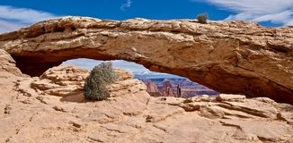 Natural sandstone arch. Panoramic view. Mesa Arch. Canyonlands National Park. Moab. Cedar City. Utah. United States Royalty Free Stock Images