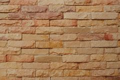 Natural sandstone brick wall background royalty free stock photography
