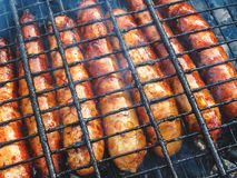 Natural sausages fried on the grill. BBQ.  Stock Image
