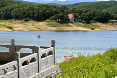Natural scenery, jilin province SongHua lake. The balcony in front of the beautiful scenery, the boat, the lake, the mountains far away stock photo