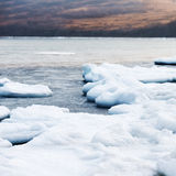 Natural sea ice blocks breaking up against shore. Natural sea ice blocks breaking up against shore and ice during freezing winter weather. Arctic aquatic nature Stock Photos