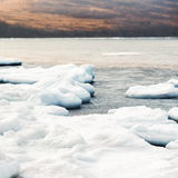 Natural sea ice blocks breaking up against shore. Natural sea ice blocks breaking up against shore and ice during freezing winter weather. Arctic aquatic nature Stock Photography