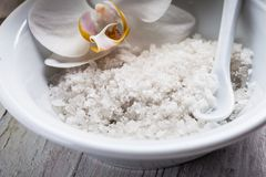 Seasalt spa concept. Natural sea salt in white ceramic bowl, spa concept Stock Photo