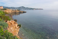 Natural seaside landscape Ibiza. Natural seaside landscape with red rocks and clear water in Ibiza, Balearic islands, Spain in December Royalty Free Stock Images