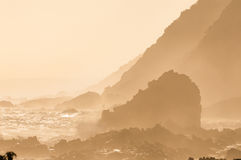 Natural sepia coastal sunset scene. A natural sepia sunset scene of the coast along the Garden Route in the Eastern Cape Province of South Africa Stock Photo