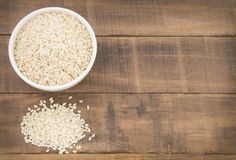 Natural sesame seeds - Sesamum indicum. Sesame seeds contain a high amount of protein Royalty Free Stock Photography