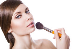 Natural sexy woman with cosmetic brush Royalty Free Stock Photography