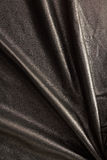 Natural shiny black leather background. Natural shiny black folded leather vertical background Royalty Free Stock Image