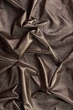 Natural shiny black leather background. Natural shiny brown folded leather vertical background Stock Photo