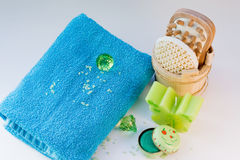 Natural Skincare Beauty Products. Blue towel soap candles brushes for spa and aromatherapy stock image