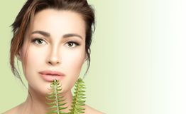 Natural skincare. Beauty Spa Woman with Fresh green leaves. Health and spa treatment concept royalty free stock photos