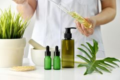 Natural skincare cosmetics research and development concept, Doctor formulating new beauty products from organic natural plants.