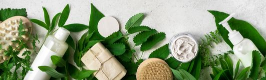 Natural skincare and leaves. Natural cosmetics and green leaves on white stone background, banner. Natural organic skincare, bio research and healthy lifestyle stock photography