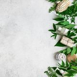 Natural skincare and leaves. Natural cosmetics and green leaves on white stone background, copy space. Natural organic skincare, bio research and healthy royalty free stock photography