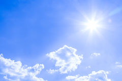 Natural sky background and radiating rays in a blue sky with clouds. That suitable for background, backdrop, wallpaper, display an Stock Photography
