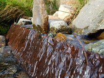 Natural small waterfall. Small waterfall in the middle of a stream Royalty Free Stock Photography