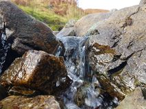 Natural small waterfall. Small waterfall in the middle of a stream Stock Image
