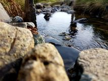 Natural small waterfall. Small waterfall in the middle of a stream Royalty Free Stock Photos