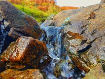 Natural small waterfall. Small waterfall in the middle of a stream Stock Photography