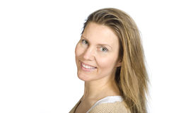 Natural smile. Portrait of smiling woman wearing an ecological, nitted sweater Stock Images