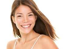 Natural smile - woman. Natural smile. Woman smiling happy - portrait of joyful content girl with big smile. Mixed race Asian Chinese / Caucasian female model in royalty free stock images