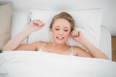 Free Natural Smiling Blonde Lying In Bed With Closed Eyes Stock Photo - 34400630