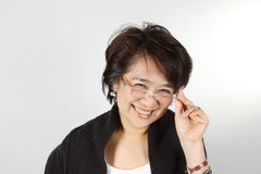 Natural smily woman. Asian Woman with natural smily face wearing glasses Royalty Free Stock Images