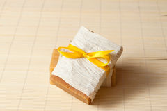 Natural soap. S tied with a ribbon on a bamboo mat Stock Photography