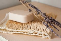 Natural soap bar with some decoration. Natural soap bar on a sisal brush with some dried lavender flower decoration stock photo
