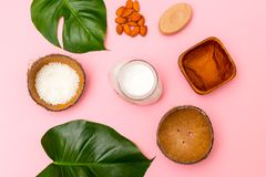 Natural soap and body organic cream on pink background. Flat lay royalty free stock photo