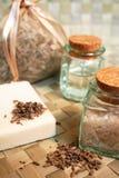 Natural soap, bottles of sea salt, dry lavender Stock Image