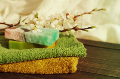 Natural soap of handwork, towel, and spring branches of an apricot Royalty Free Stock Images