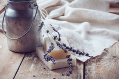 Natural soap, lavender, salt, cloth. Old cans on a wooden board, rustic hygiene items for bath and spa Stock Photo