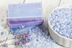 Natural soap, lavender, salt on a wooden board, hygiene items for bath and spa. Royalty Free Stock Photo