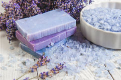 Natural soap, lavender, salt on a wooden board, hygiene items for bath and spa. Royalty Free Stock Photos