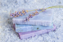 Natural soap, lavender, salt on a wooden board, hygiene items for bath and spa. Stock Photo