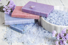 Natural soap, lavender, salt on a wooden board, hygiene items for bath and spa. Royalty Free Stock Images
