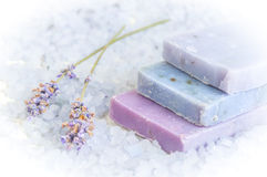 Natural soap, lavender, salt on a wooden board, hygiene items for bath and spa. Stock Image