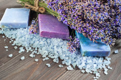 Natural soap, lavender, salt on a wooden board, hygiene items for bath and spa. Royalty Free Stock Photography