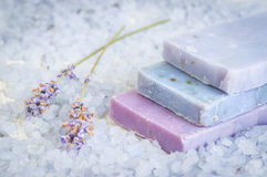 Natural soap, lavender, salt on a wooden board, hygiene items for bath and spa. Royalty Free Stock Image