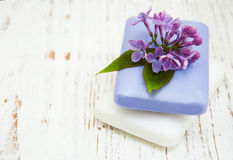 Natural soap and lilac flowers Stock Photos