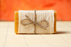 Natural soap on  mat. Natural soaps tied with a ribbon on a bamboo mat Stock Photos