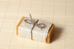Natural soap on  mat. Natural soaps tied with a ribbon on a bamboo mat Stock Images