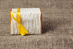 Natural soap on the natural rough fabric. Natural soap with yellow ribbon on the natural rough fabric Stock Photo