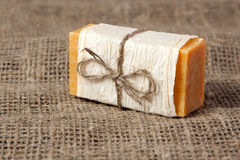 Natural soap on the natural rough fabric. Natural soap with linen ribbon on the natural rough fabric Royalty Free Stock Image