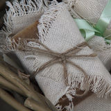 Natural soap for spa. Wrapped in a cloth, gift option Stock Image