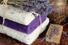 Natural soap, towels and lavender Stock Photos